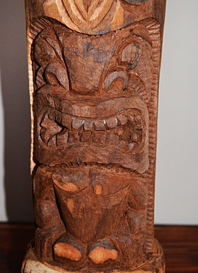 Three Ku carvings stand tall in front of the Ka'u Outpost gallery.