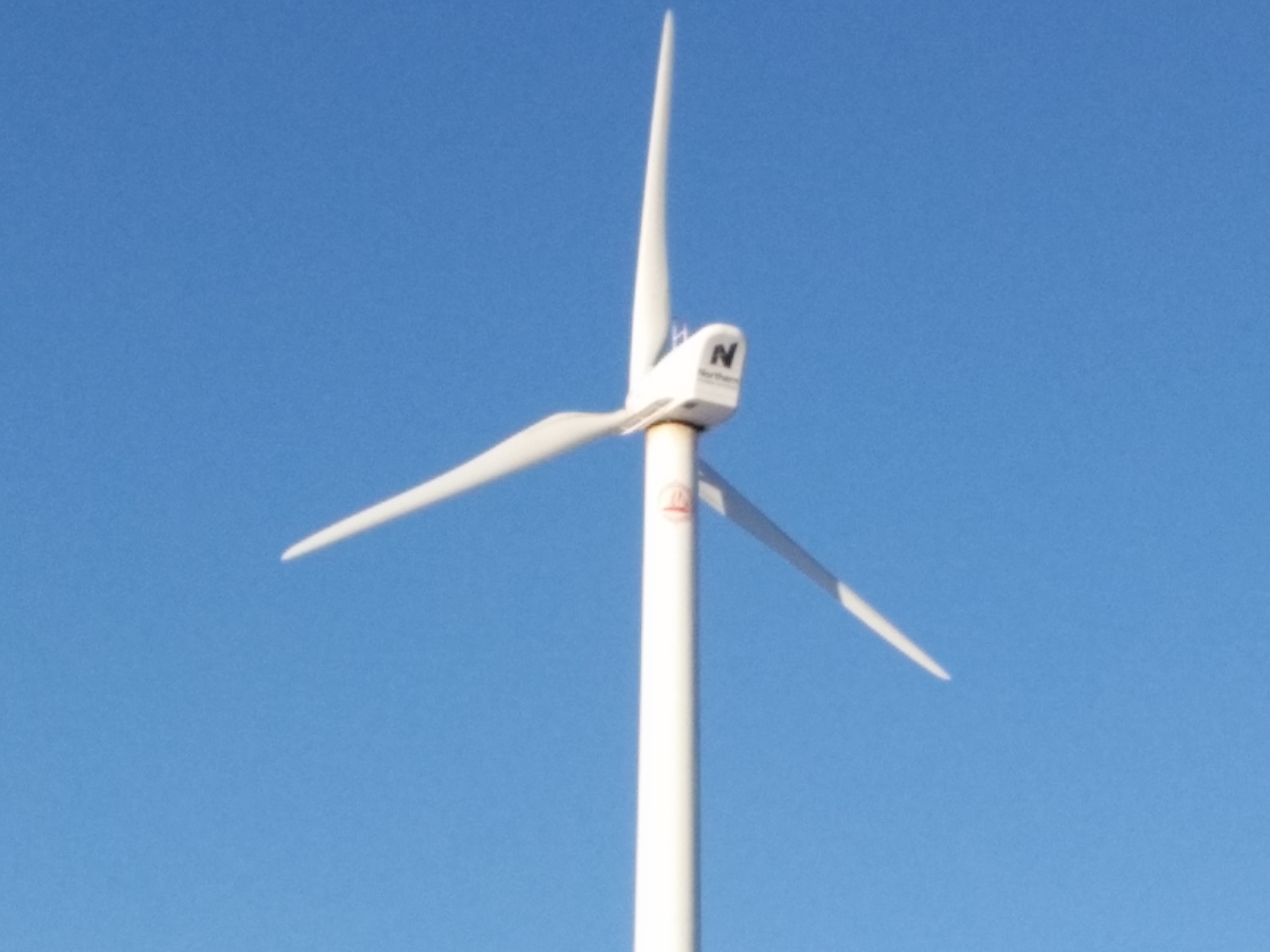 100 kW Wind Turbine Interconnected to Utility Grid Through Building ...