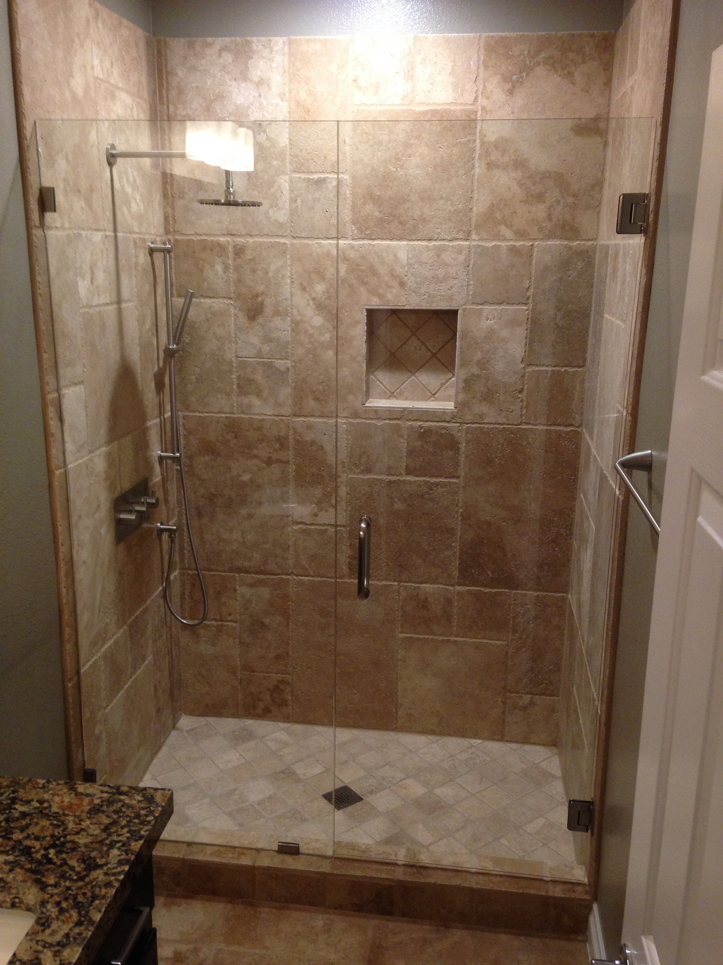 Inline shower with pivot door