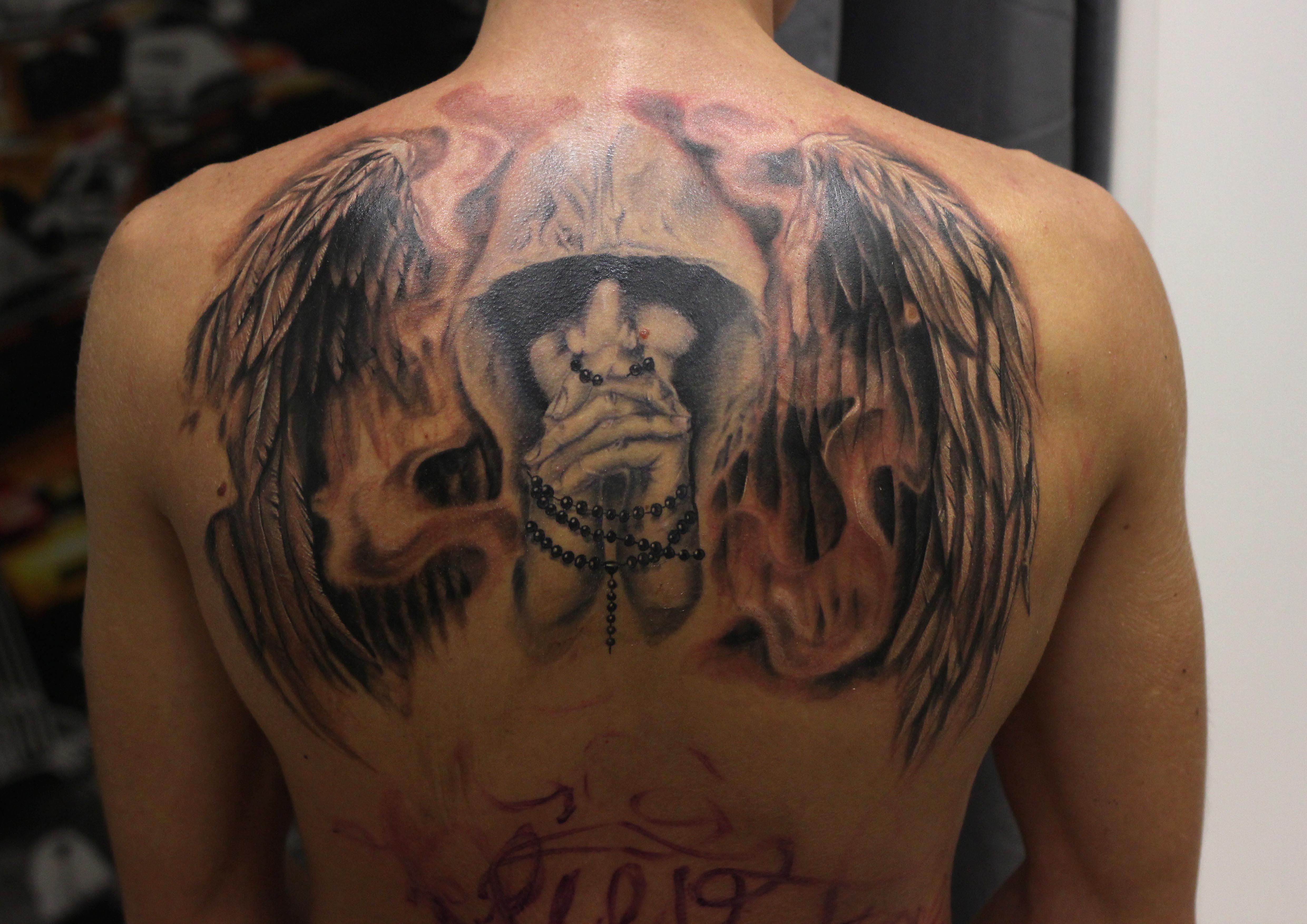 Тату ангел на спине