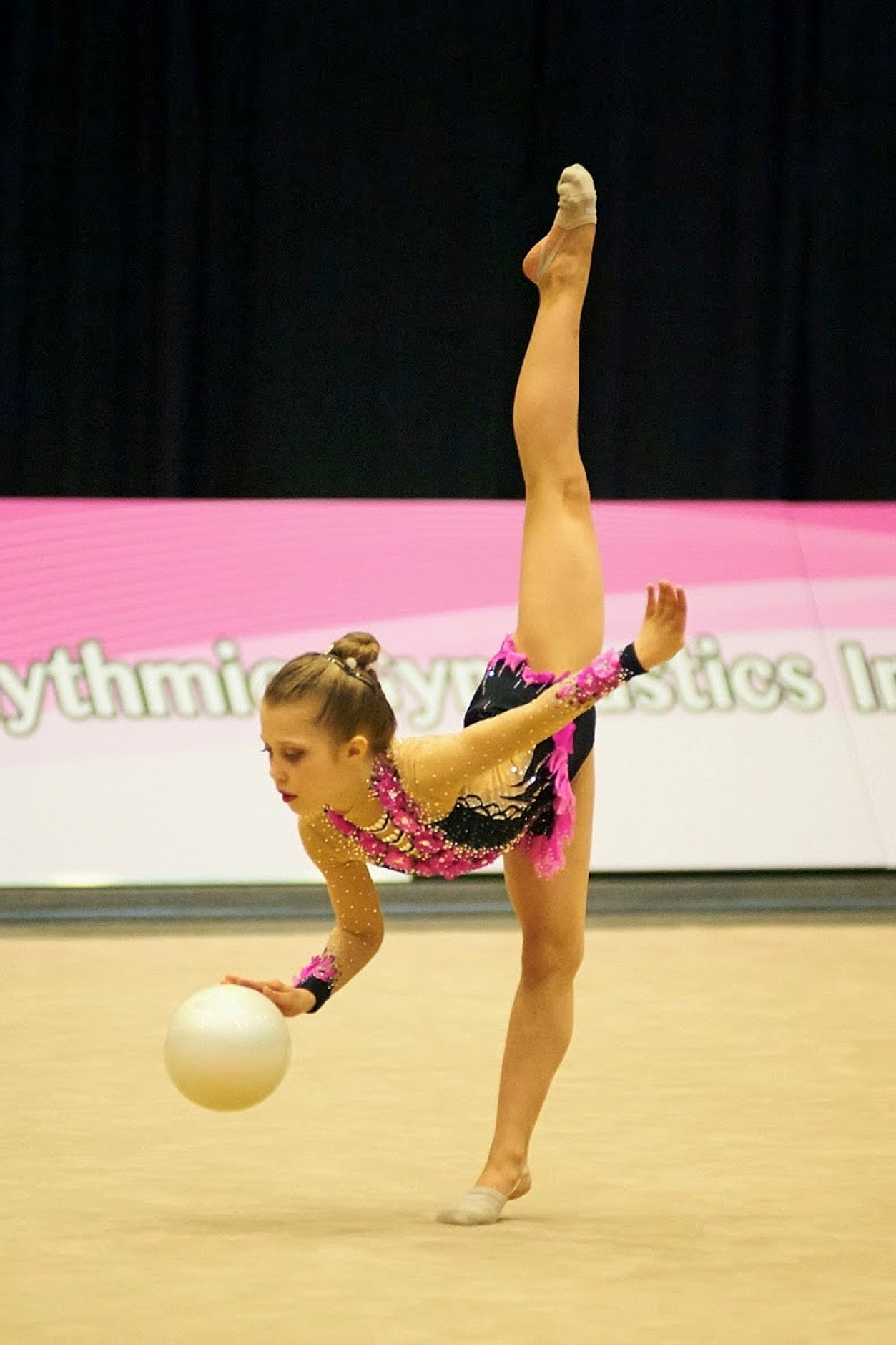 rhythmic gymnastics Rhythmic gymnastics is a sport in which individuals or groups of five or more manipulate one or two pieces of apparatus: rope, hoop, ball, clubs, ribbon and.