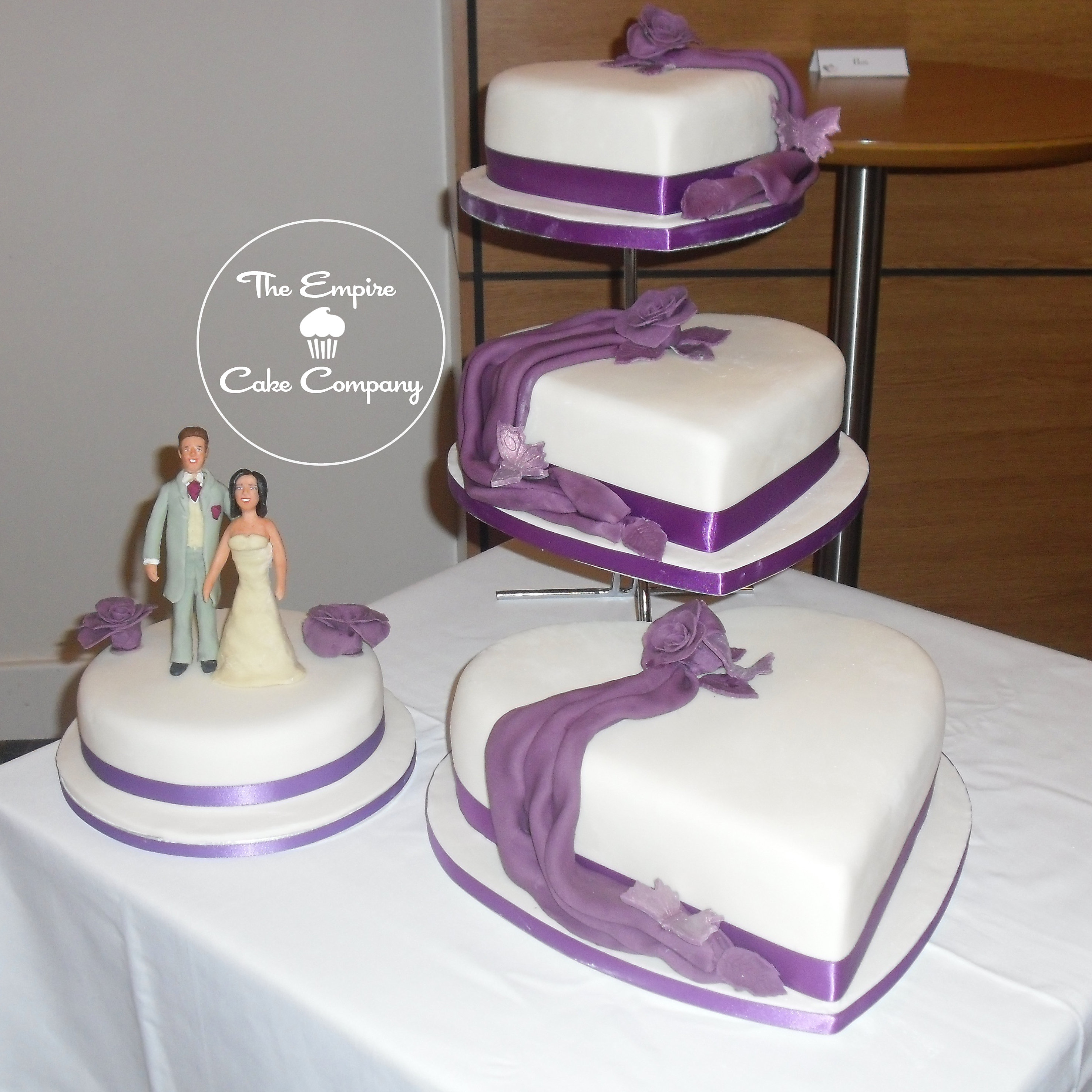 tier heart shaped wedding cake in ivory and cadbury purple ...