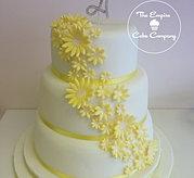 3 tier yellow daisy cake