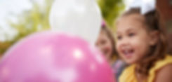 girl with balloons_979x466.jpg