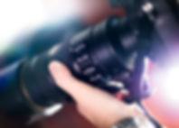 Hand Holding a Camera
