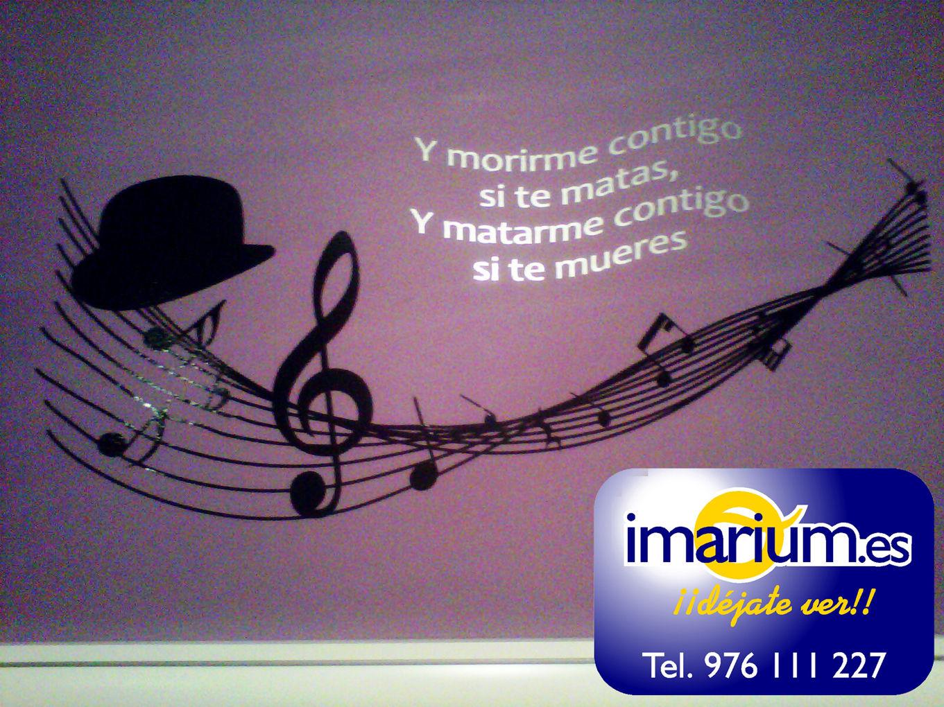 vinilos decorativos granada cabeceros dormitorios fotomurales con dibujos y frases de canciones populares decoracion paredes