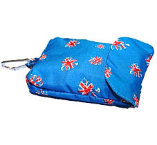 Blue MacPAWS rain coat. The Ran coat which can be clipped. Separate the rain coat from the pouch.