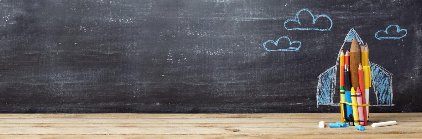 Chalk board with a rocket drawn on it