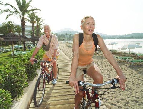 50s couple riding on boardwalk