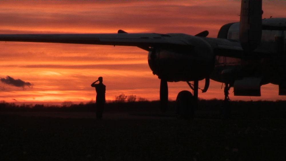 Photo of B-25 bomber at sunrise