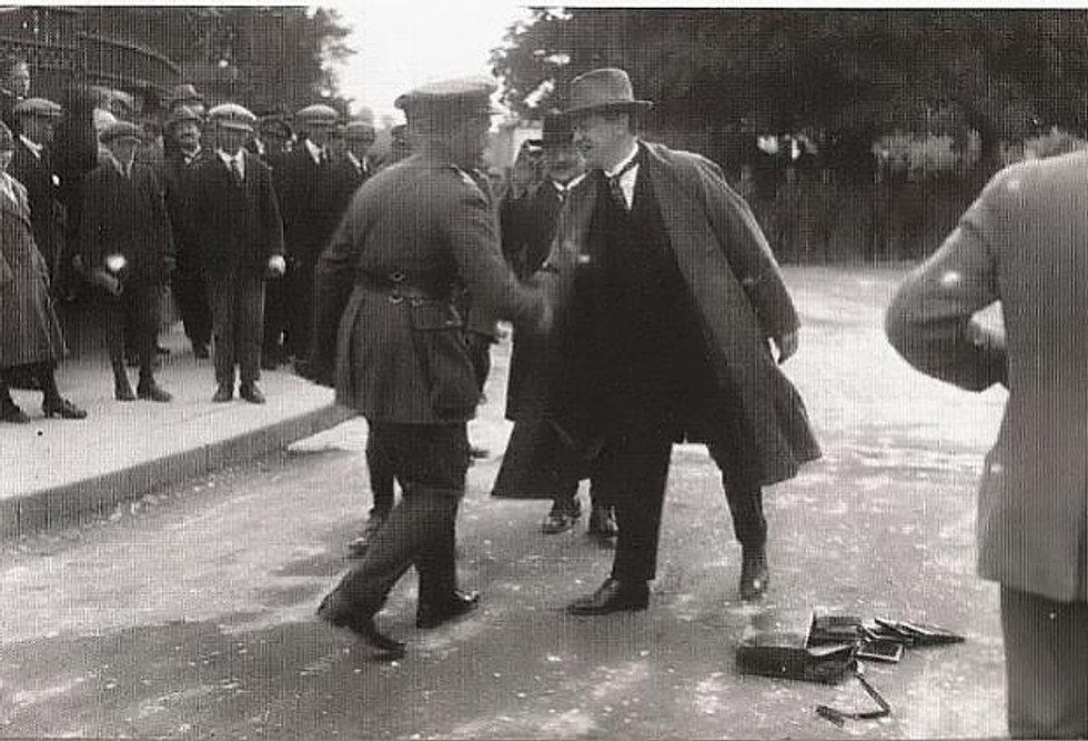 Michael Collins greets Seán