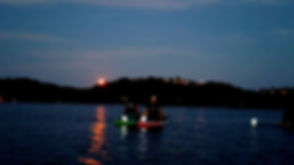Full Moon SUP couple on boards with lant