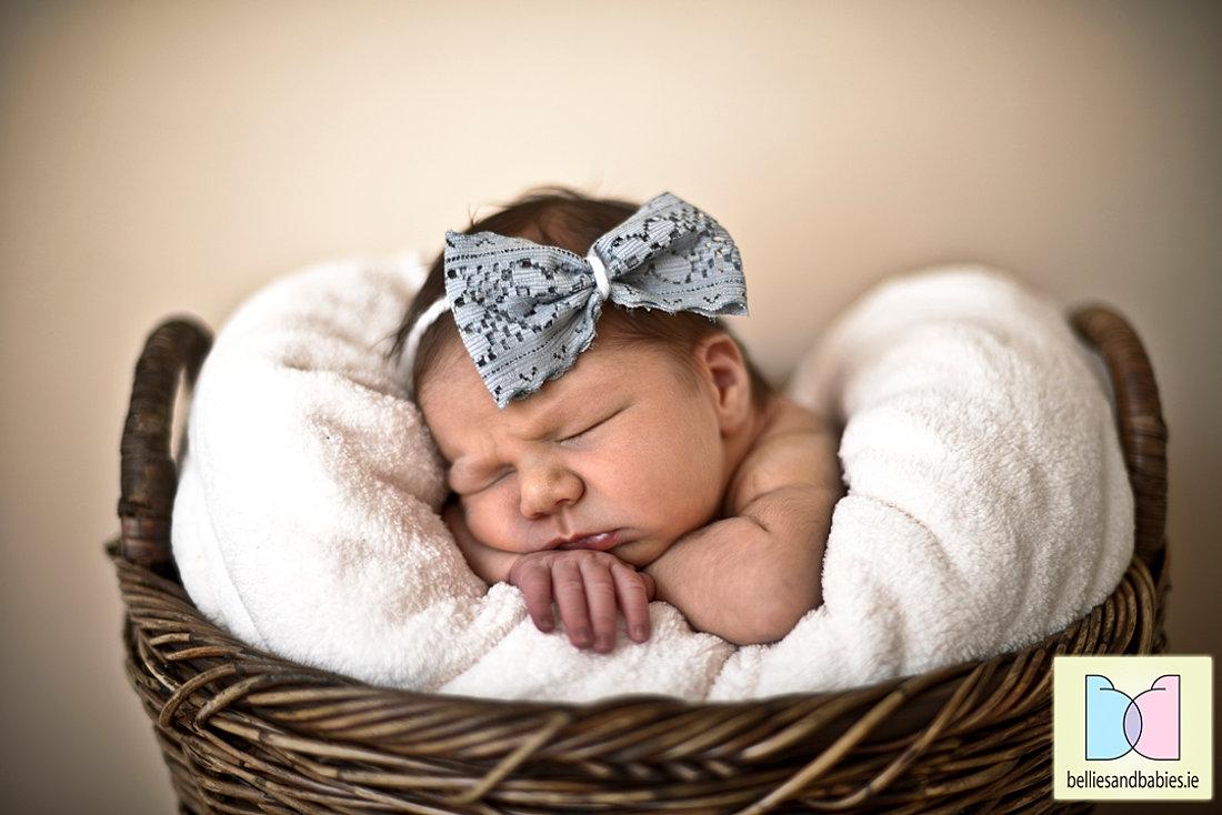 Cute newborn in basket photo