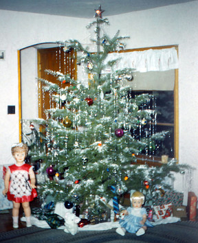 Our Christmas tree in the early 60s. Linda and I still have nightmares about that scary life size doll in the red dress!