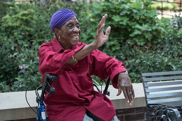Photo of senior woman waving.  Photo by Matt Oner