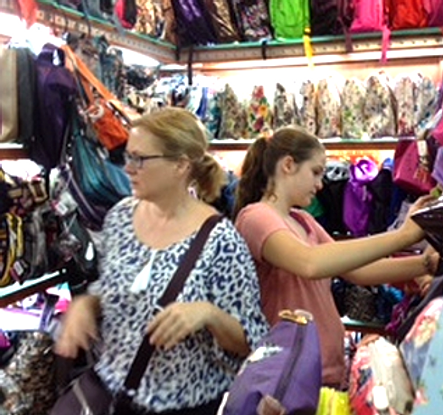 Mum and daughter shopping for bags