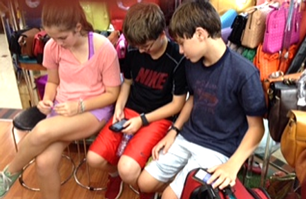 Kids playing on phones
