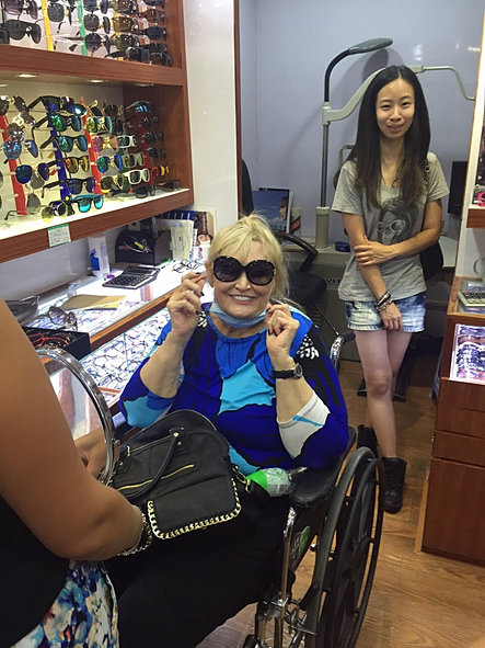 gloria buying sunglasses on a shoppi