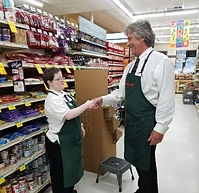 Young woman with disabilities shaking hands with her Safeway supervisor