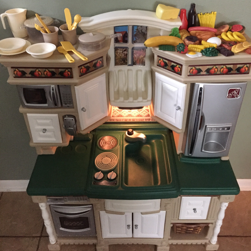 The Lifestyle Dream Kitchen by Step2 is one of the most realistic play kitchens your child will ever play with. It's upscale, compact and designed to match today's home decor with