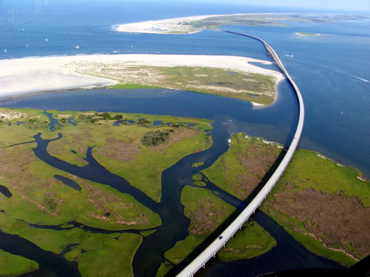 Obx biplanes offers exciting biplane rides over the outer for Oregon inlet bridge fishing report