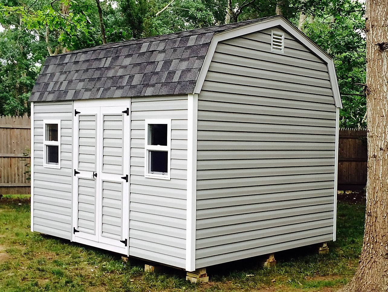barn style doors for shed sliding barn door open revealing glass barn style shed 2 singlehung windows a double door that locks cape cod grey horizontal siding roof color charcoal grey dualventing