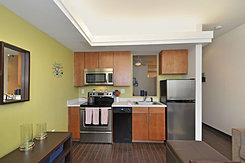 Floor plans the continuum for Studio apartment kitchen appliances