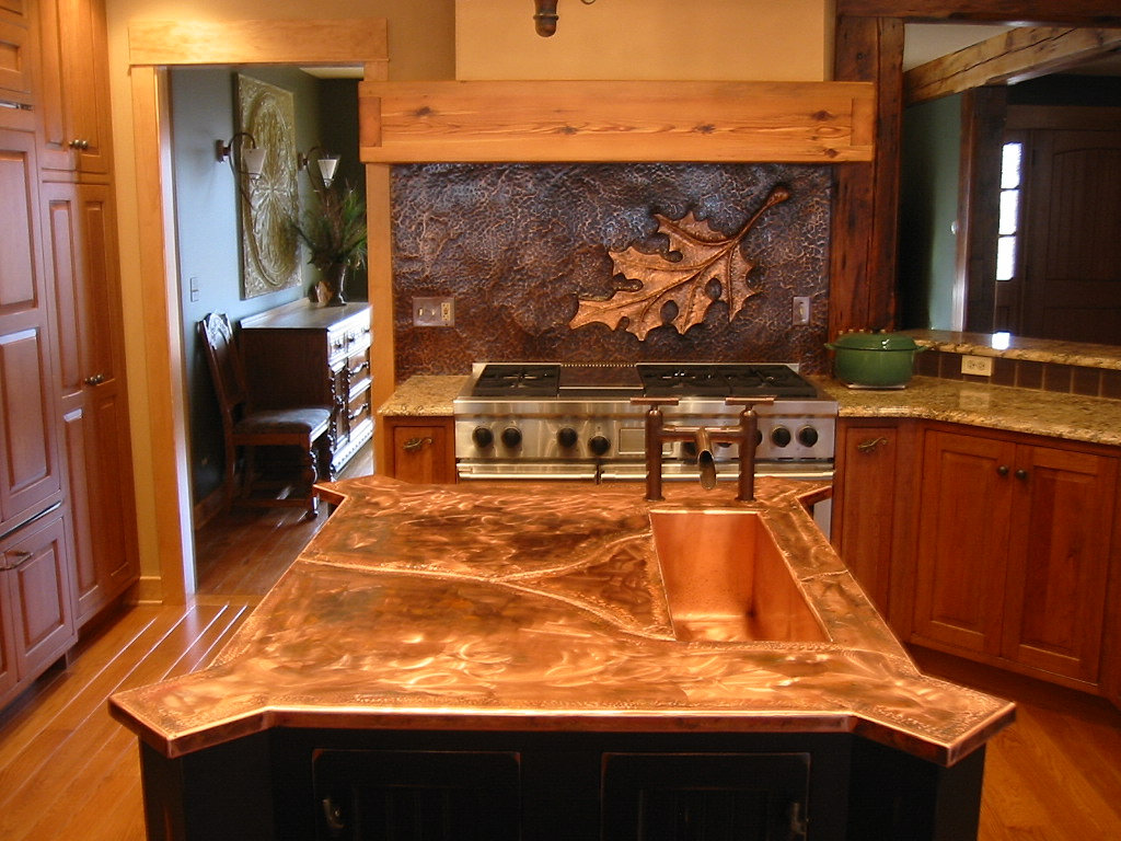 Oak leaf copper backsplash Custom copper island with copper sink