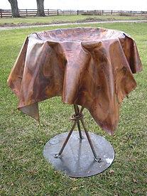 Copper tablecloth birdbath