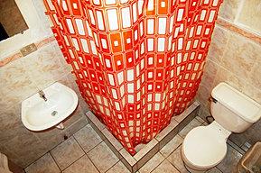 Baño privado de habitación Deluxe