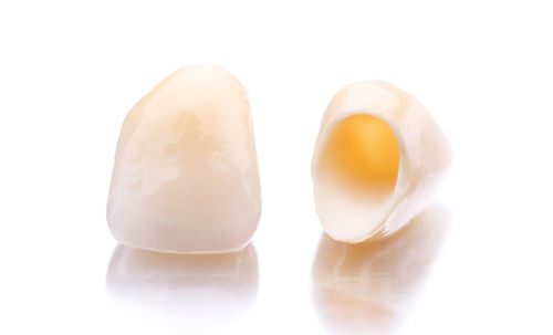 Close-up of two prosthetic teeth isolate