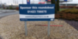 Metal posted roundabout sign
