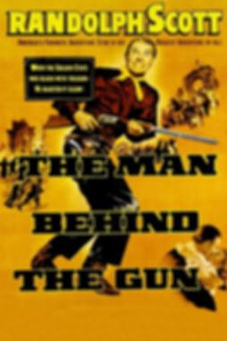 銃の後ろに立つ男.jpg