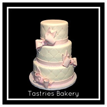 White Quilted Cake with Pink Bows