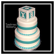 Classic White and Teal Baby Boy Cake