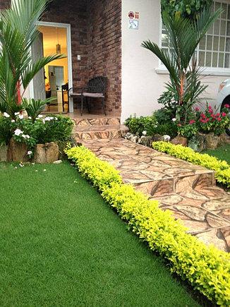 Dise o y construcci n de jardines en panam for Jardines pequenos para frentes de casas