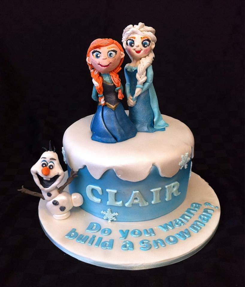 This Frozen theme cake features handmade figures of Anna, Elsa and
