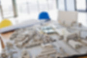 A desk with building blocks on it representing a building constructio site