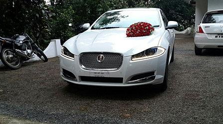 Jaguar car rental hire in kerala jaguar xf rental for Who owns jaguar motor company