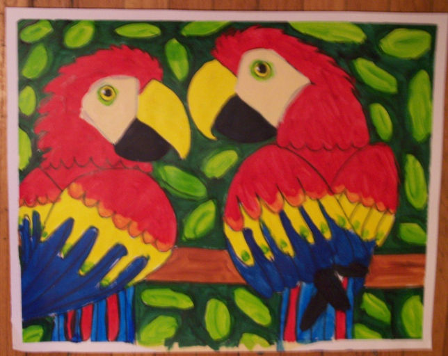 2 scarlet macaws