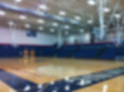 St. Dominic High School Gym basket ball court and bleacher seating. DE|SL LLC