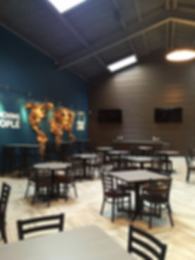 Element Church concourse coffee cafe seating lounge and decorative wall art. DE|SL LLC