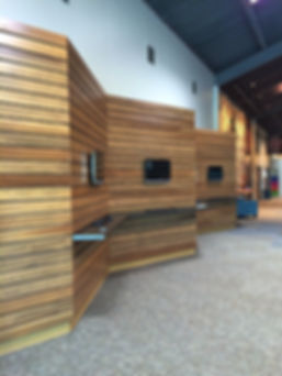 Element Church renovated concourse with undulating wood plank feature wall and check-in stations. DE|SL LLC