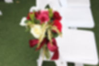 weddin flower arrangement on chair