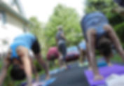 Teaching a group of yoga students
