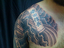 Black and grey asian chest piece
