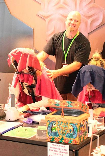 ad tech david black shirt seated massage