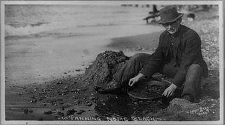 Man panning gold on Nome Beach.jpg
