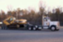 Excavator and Semi.jpg