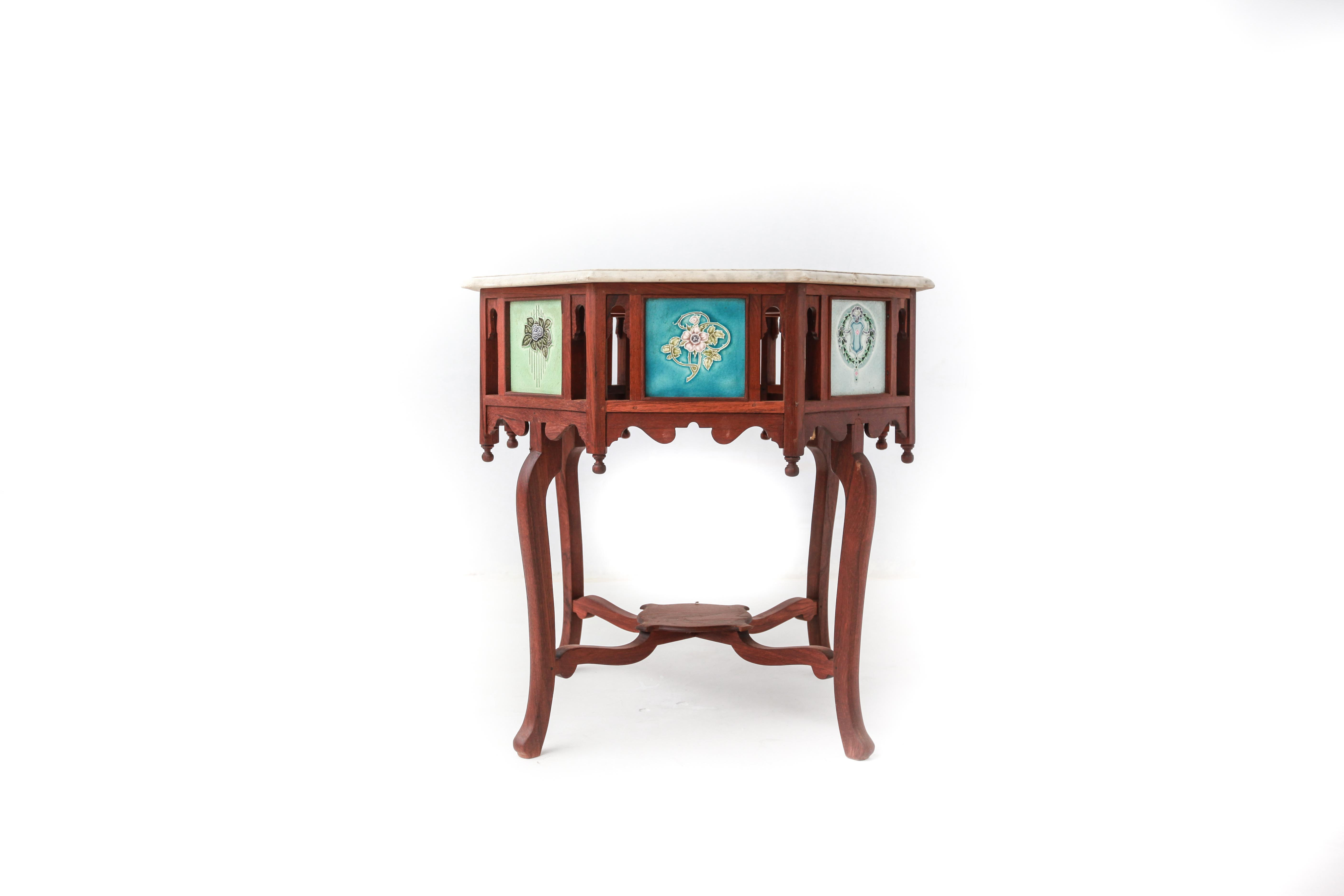 This pair of large burmese arm chairs is no longer available - Octagonal Marble Top Table In Burmese Teak With Ceramic Tiles
